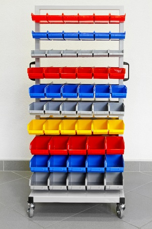 storage warehouse: Cart with colorful plastic shelves for workshop
