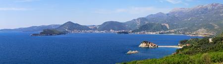 islet: Montenegro coast panorama with St. Stefan islet Stock Photo