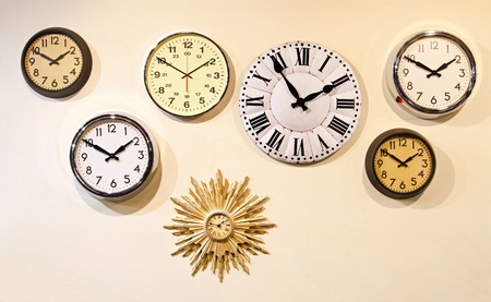 clocks: Seven different styles analog clocks on wall
