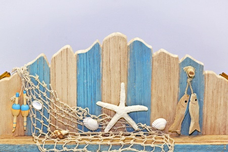 fish net: Decorative wooden wall with seaside ornaments attached