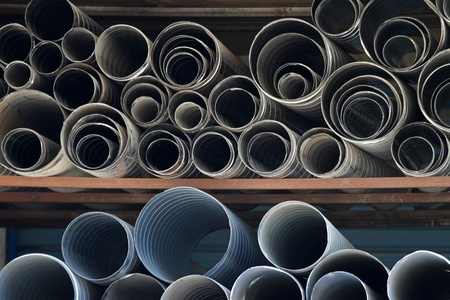 ductile: Ductile iron and zinc pipes at warehouse