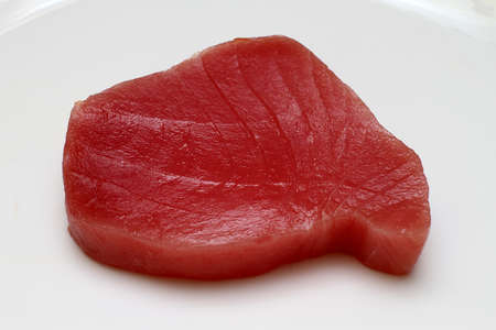 tuna: Fresh and raw tuna steak at plate Stock Photo