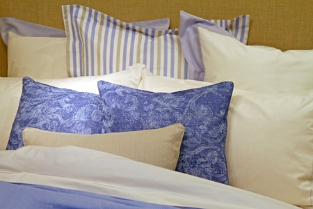white sheet: Cotton bed sheets with big pile of pillows