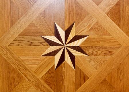 marquetry: Forma de estrella de marqueter�a de madera en el parquet del piso