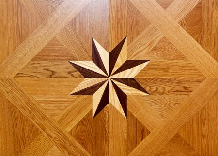 marquetry: Wood marquetry star shape at floor parquet