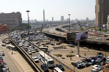 cairo: CAIRO, EGYPT - MARCH 03: Flyover at square in Cairo on MARCH 03, 2010. Flyover and square in central Cairo, Egypt.