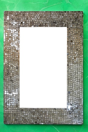 miror: Rectangular silver miror frame at green wall