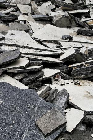bumpy: Massive asphalt damage with cracks at street