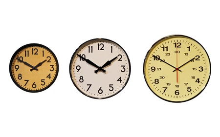horizontal position: Three clocks in horizontal position on wall