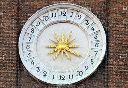 24 hour: Medieval time 24 hours clock with golden sun Stock Photo