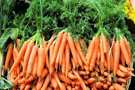Bunch of fresh organic carrots at market photo