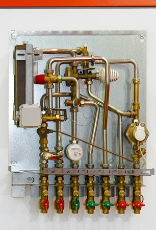 Heating instalation pipes and meter for home Stock Photo - 10900508