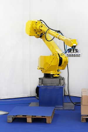 Robotic arm for packing in logistic warehouse photo