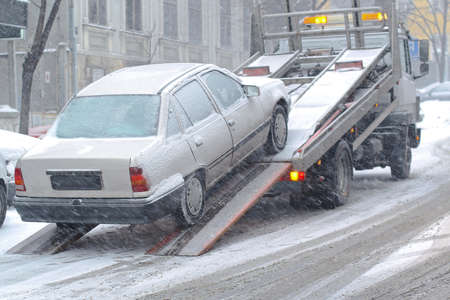 roadside assistance: Car breakdown and towing assistance at snowy day