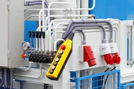 hydraulic: Levers and buttons for production machinery control