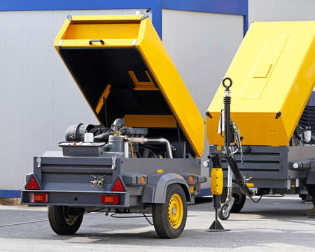 compressor: Mobile air compressor unit at construction site Stock Photo