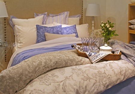 Contemporary bedroom with big bed and pile of pillows