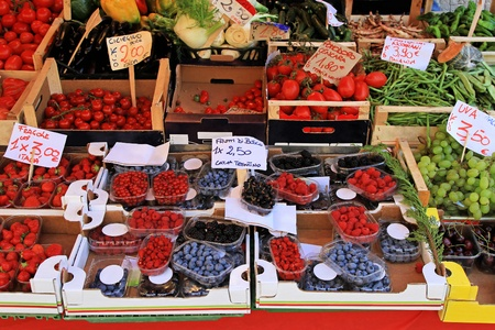 Big farmers market stall filled with organic fruits photo