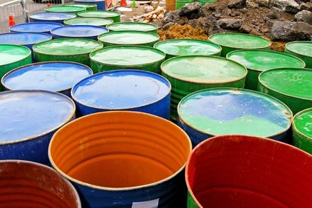 oil drum: Large group of standard metal oil barrels