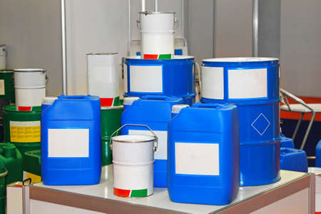 chemical industry: Blue barrels and buckets of chemical substance
