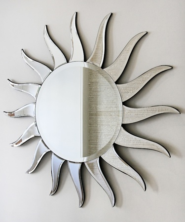 wall mirror: Wall mirror in sun shape with rays Stock Photo