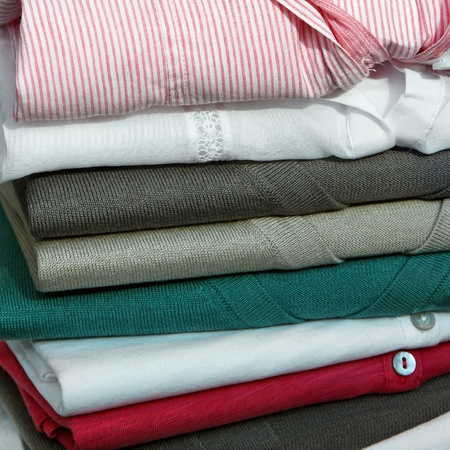 pullovers: Big pile of modern sweaters and pullovers