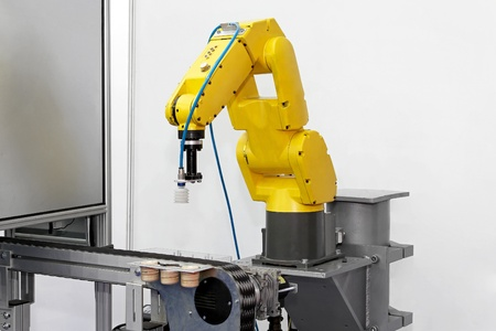 arm in arm: Robotic arm at production line in factory Stock Photo