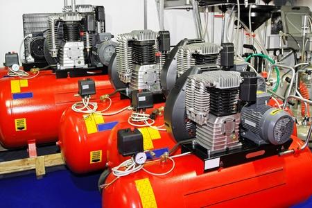compressor: Red air compressors for garage work shop Stock Photo