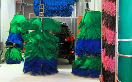 Car wash service with mop style brushes photo