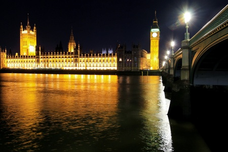 Houses of Parliament Big Ben Tower and Westminster Bridge photo
