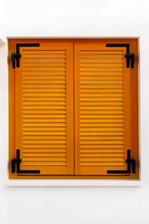 wood blinds: Retro wooden window shutters on white wall
