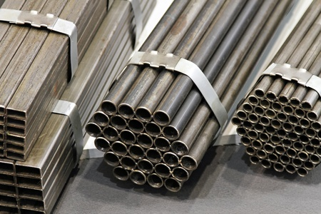 Several stacks of construction industry steel pipes photo