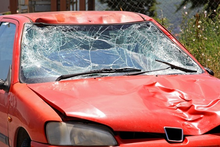 Broken windscreen at red car in traffic accident Stock Photo - 11733716