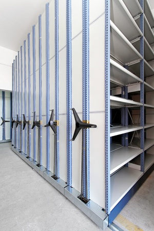 Automated shelving system with mobile cabinet for documents photo