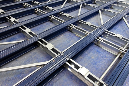 metal base: Metal base and rollers for automated shelving system