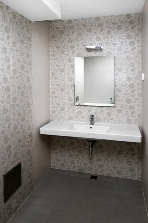 White sink and floral tiles in small bathroom photo