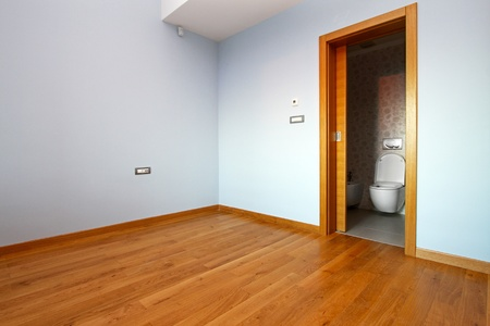 Empty room with blue walls in renovated home photo