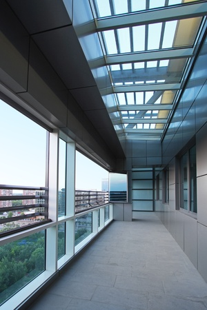 Long terrace with sky window in new penthouse apartment photo