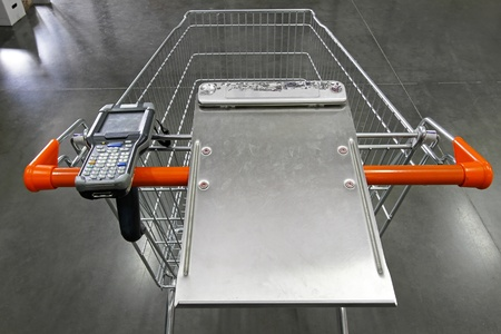 Shopping trolley with portable barcode scanner device photo