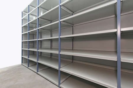 Long empty metal shelf in storage room photo
