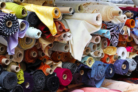 textile industry: Fabric rolls in shelf for fashion industry Stock Photo