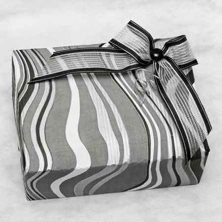 Modern silver gift box with decorative bow Stock Photo - 11928351