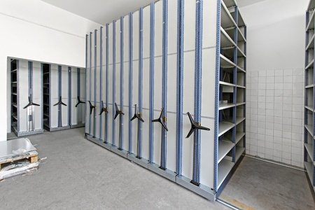 movable: Automated shelving system with mobile cabinet for documents Stock Photo