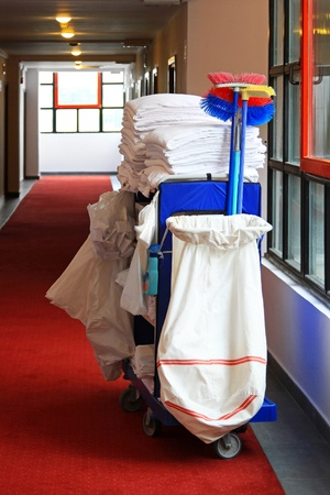 Cleaning utility janitorial cart in hotel corridor