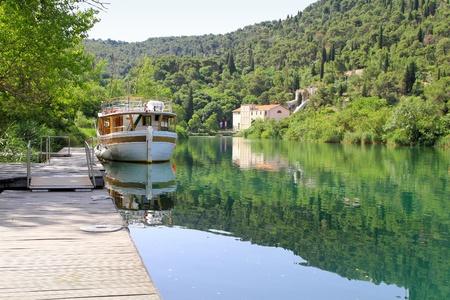 power boat: Big boat at dock in National Park Krka Stock Photo