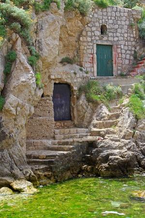 croatia dubrovnik: Two doors entrance to caves near the sea Stock Photo