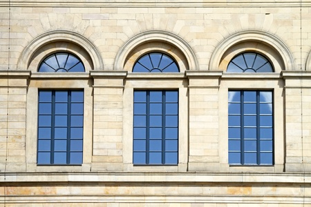 Three arch blue windows at stone building Stock Photo - 12116671