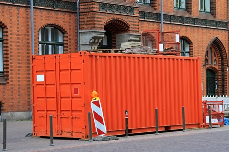 Orange cargo container at city street photo