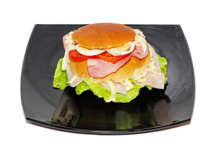 Big bun sandwich at black plate Stock Photo - 12351031