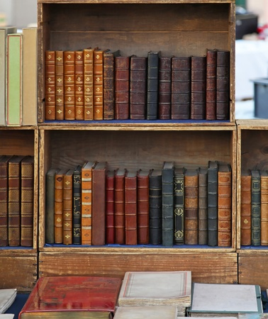 Retro style books in old bookcase Stock Photo - 12351025
